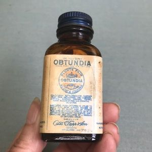 Antique bottle with Obtundia on label.
